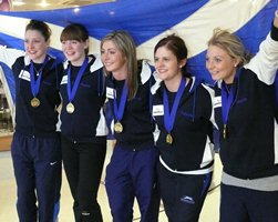 Lauren Gray (left) with Team Muirhead on their triumphant return to Scotland as World Champions.